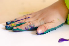 Child painting with hands Stock Photo