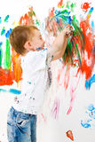 Child painting and having a lot of fun stock image