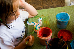 Child Painting Her Craft Project Stock Photography