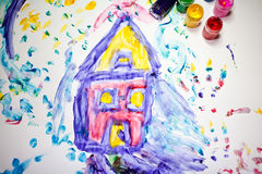 Child painting of a house royalty free stock photography