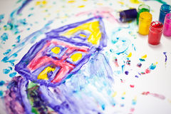 Child painting of a house. Child fingerpainting of a house in vivid colors stock photo