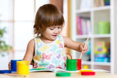 Child painting in kindergarten or playschool Royalty Free Stock Images