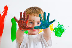 Child painting with messy hands Stock Images