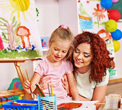 Child painting with mum. Child with mother painting . Child care Stock Photo