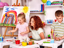 Child painting with mum. Child with mother painting . Lesson in child club Royalty Free Stock Photography