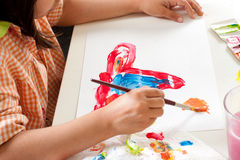 Child painting with paintbrush Stock Photos