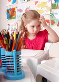 Child painting by pencil in art class. Little girl  painting by pencil in art class Royalty Free Stock Photos