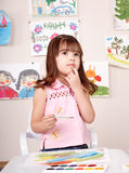 Child painting picture in art class. Royalty Free Stock Photo