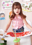 Child painting picture in art class. Little girl painting picture in art class Stock Photo