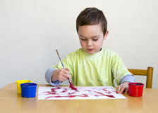 Child painting picture Stock Photography