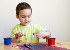 Child painting picture Stock Images