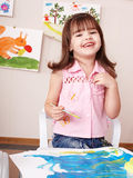 Child painting picture  in play room. Stock Photography