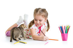 Child painting and playing with kitten Stock Photos