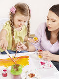 Child painting in preschool. Royalty Free Stock Image