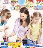 Child painting in preschool. Royalty Free Stock Photos