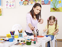 Child painting in preschool. Royalty Free Stock Images