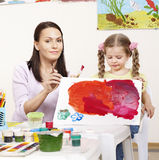 Child painting in preschool. Royalty Free Stock Photography