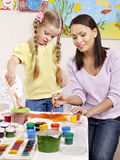 Child painting in preschool. Happy child painting in preschool royalty free stock images