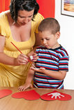 Child painting in preschool Stock Images
