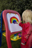 Child painting rainbow Stock Photography