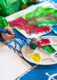 Child painting with roller. Hand of child painting with roller Royalty Free Stock Photography