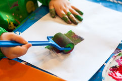 Child painting with roller. Hand of child painting with roller Stock Images