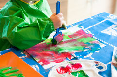 Child painting with roller. Hand of child painting with roller Stock Photography