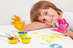 Child painting showing hands. Happy child boy painting and showing hands Royalty Free Stock Photo