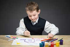 Child painting something Royalty Free Stock Images