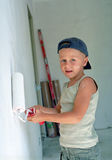 Child painting wall Stock Images