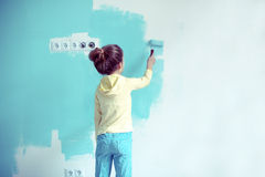 Child painting the wall Royalty Free Stock Photography