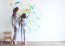 Child painting wall Stock Photos