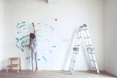 Child painting wall Royalty Free Stock Photography