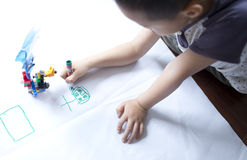 Child painting on the white paper Royalty Free Stock Photo