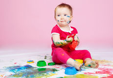 Child with paints Stock Images