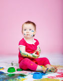 Child with paints Royalty Free Stock Images