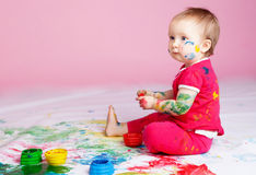Child with paints Royalty Free Stock Photography