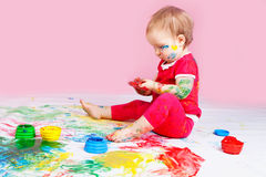 Child with paints Stock Photos