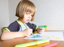 Child paints a felt-tip pen Royalty Free Stock Images