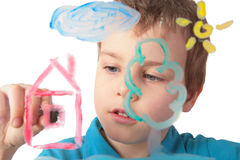 Child paints on glass Stock Photos