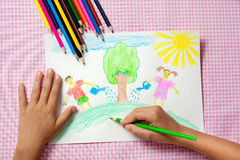 Child paints a picture of pencils about protecting nature. Stock Photo