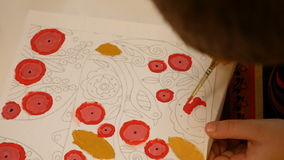 Child paints watercolor picture with paint brush stock video