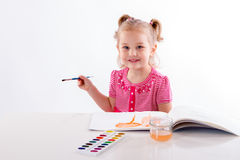Child paints a white background table stock photos