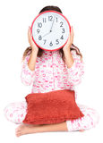 Child in pajamas wearing a clock in place of her face Stock Image