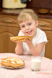 A child with pancakes Stock Photo