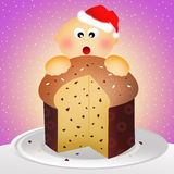 Child with panettone Royalty Free Stock Images