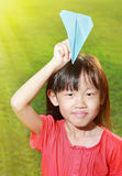 Child with paper airplane Stock Photography