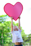 Child with paper heart Royalty Free Stock Photo
