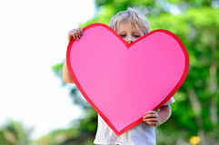 Child with paper heart Royalty Free Stock Images