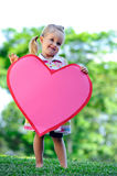 Child with paper heart Royalty Free Stock Image